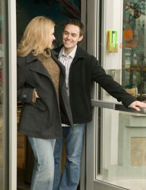 Man-opening-door-for-woman